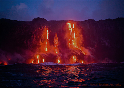 Lava flowing into the ocean at Volcanoes Nat'l Park