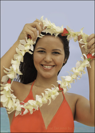 Hawaiian girl giving a lei to viewer