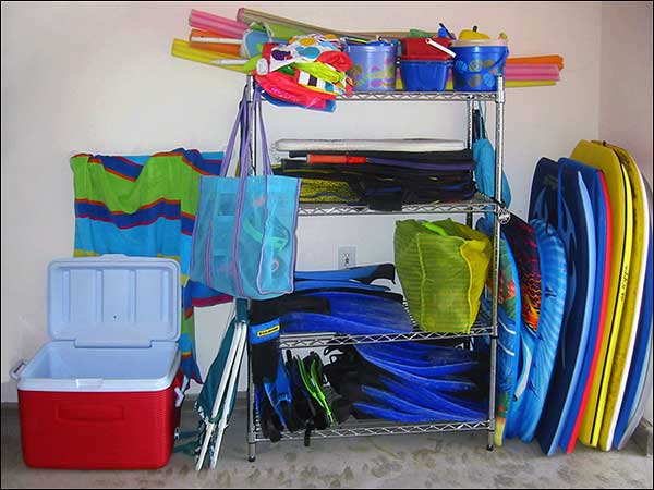 Boogie boards, snorkel equipment, children's sand toys, tennis rackets, ice chest, beach towels
