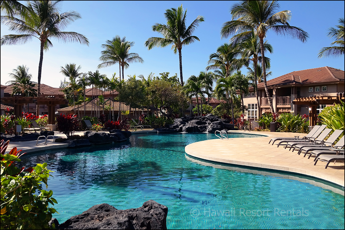 Waikoloa Colony Villas large pool and gurgling lava rock waterfall surrounded by fragrant tropical landscaping
